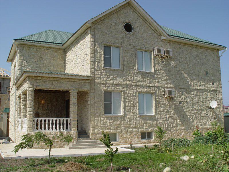 Облицовка дома искусственным камнем как дополнительная изоляция