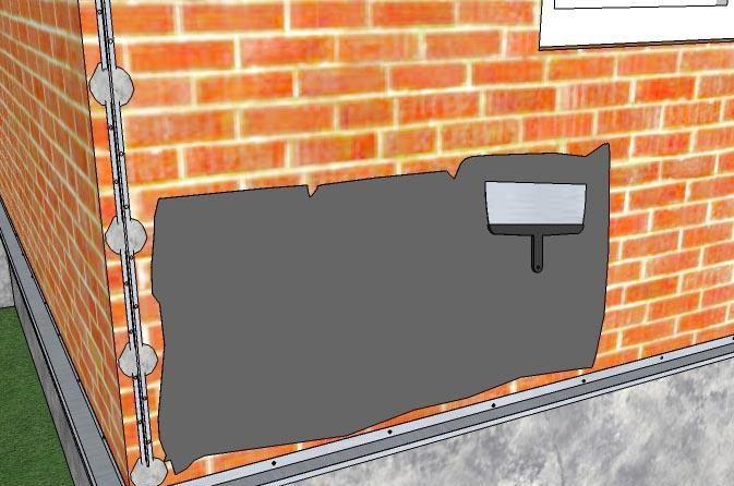 На загрунтованную стену наносим тонкий слой клея