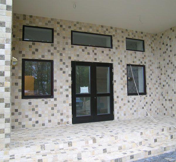 Отделка фасада загородного дома - облицовка природным камнем