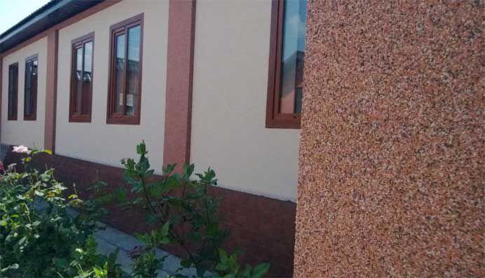 Мраморная штукатурка на фасаде частного дома