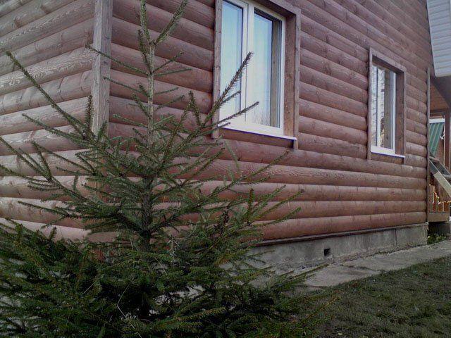 Облицовка дома под сруб деревянным блок хаусом