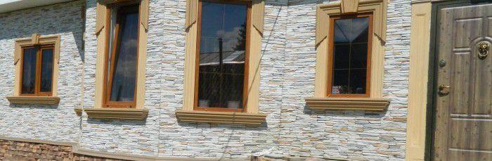 Рамы коричневого оттенка хорошо подходят к отделке фасада
