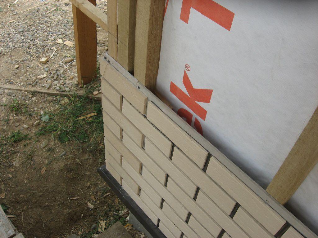 Утепление и декоративная отделка стен дома из бруса