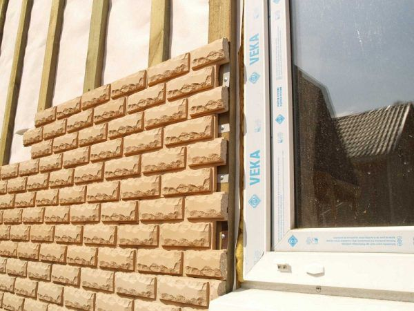 Процесс облицовки фасадной плиткой