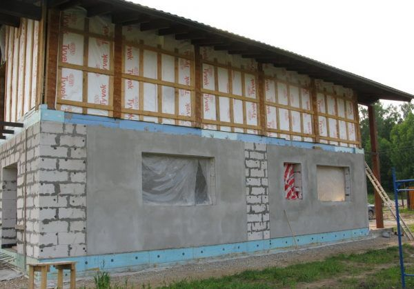 Наружное оштукатуривание стен