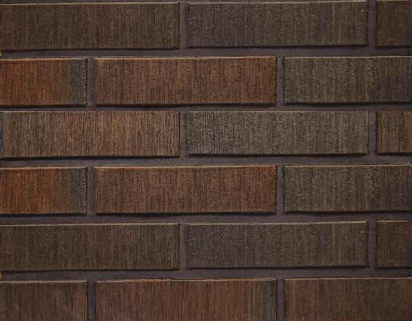 Клинкерный кирпич от Terca ручной формовки. Стоимость одного блока - от 75 рублей. Дорого, но выглядит безумно красиво