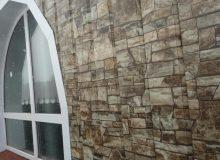 Пример обшивки дома сайдингом под камень