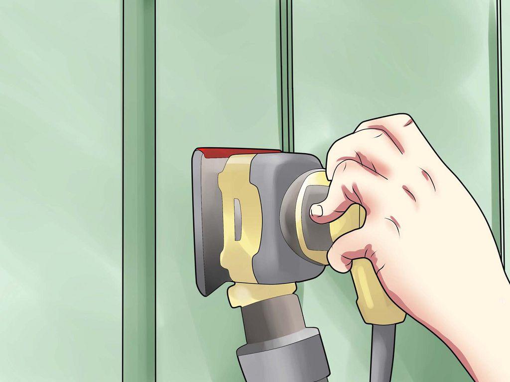 Куда более приятный и быстрый способ, как содрать старую краску своими руками – использовать шлифовальную машинку